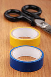 Insulation tape on wooden table Royalty Free Stock Photos