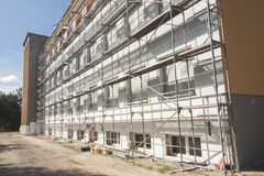 Insulation for thermal protection. Work on scaffolding stock images