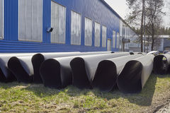 Insulation tubes on the gras. Thermo insulation. Chemical Rubber Factory Royalty Free Stock Photo