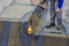 Insulation worker and propane blowtorch 3 Stock Images