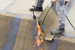 Insulation worker with propane blowtorch 2 Stock Images
