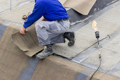 Insulation worker with propane blowtorch Stock Images