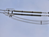 Insulator strings with corona rings on high voltage lines close-up Stock Image