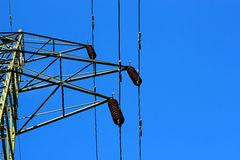 Insulators on a transmission tower. Royalty Free Stock Photo