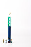 Insuli pen and miniature people Royalty Free Stock Photo