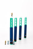 Insuli pen and miniature people Royalty Free Stock Photography