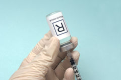 Insulin Draw. Nurse draws regular insulin from vial with insulin syringe Stock Image