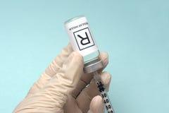 Insulin Draw. Nurse draws regular insulin from vial with insulin syringe stock image