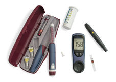 Insulin kit. Blood glucose meter, insulin pen, test strip, lancing device royalty free stock photos