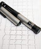 Insulin pen. Pen insulin and ECG backgroung stock photo