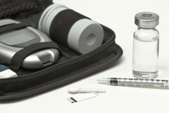 Insulin Supplies. Insulin vial, syringe, lancet, strip and diabetic travel kit case Royalty Free Stock Photos