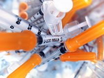 Insulin syringes. Pharmaceutical waste:group of used insulin syringes Stock Image