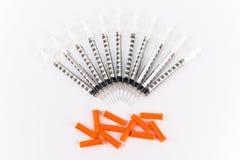 Insulininjektionssprutor på vit bakgrund Royaltyfria Foton
