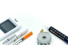Insulinpenna, sockersjuka utrustning och jämnt blodprov för glukos, Di royaltyfri bild