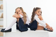 Free Insult. Insult Of Two Small Girls Children Or Sisters At School. Small Girls In School Uniform. Stock Images - 124900654