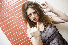 Insulting aggressive woman. Thoughtful woman sexy makeup, beauty and fashion Stock Photography