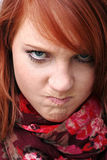 A insulting and furious expression. A young woman makes an insulting and furious expression Royalty Free Stock Photo