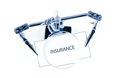 Insurance. Macro of a note with a magnifying glass Royalty Free Stock Photography