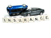 Insurance. Two cars behind the word insurance Royalty Free Stock Photography