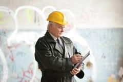 Insurance adjuster in devastated room of abandoned building stock image