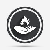 Insurance against fire. Hand holds fire flame. Insurance against fire sign icon. Hand holds fire flame symbol. Circle flat button with shadow and border. Vector Royalty Free Stock Photography