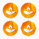 Insurance against fire. Hand holds fire flame. Insurance against fire sign icon. Hand holds fire flame symbol. Triangular low poly buttons with flat icon Stock Photos
