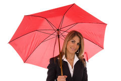 Insurance agent. Insurance Concept - Woman protected under a red umbrella Royalty Free Stock Photography