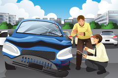 Insurance agent assessing a car accident Stock Photo