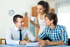 Insurance agent and couple indoors Royalty Free Stock Image