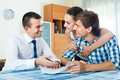 Insurance agent and couple indoors Stock Photo