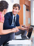 Insurance agent and customer discussing agreement terms Stock Image