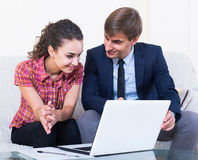 Insurance agent and customer discussing agreement terms Stock Photography