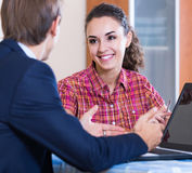 Insurance agent and customer discussing agreement terms Royalty Free Stock Photo