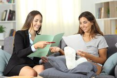 Insurance agent and disabled customer singing contract stock image