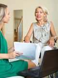 Insurance agent and disabled woman Royalty Free Stock Photo