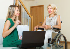 Insurance agent and disabled woman Stock Images