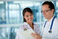 Insurance agent with a doctor Stock Photo