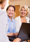 Insurance agent and female pensioners Royalty Free Stock Images