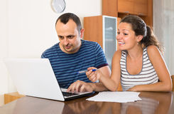 Insurance agent helping client to choose the product Stock Photo