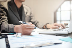 Insurance agent holding pen medical insurance, the policy and ex Stock Photo