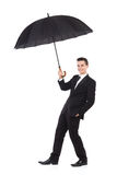 Insurance agent holding an umbrella Stock Photo