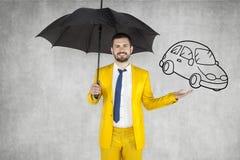 Insurance agent insure your car. Umbrella protection Stock Photos