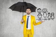 Insurance agent insure your family. Umbrella protection Royalty Free Stock Image