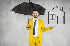 Insurance agent insure your house. Umbrella protection Stock Photo