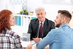 Insurance agent showing calculator with value stock image