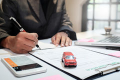Insurance agent sitting in office with transportation insurance Stock Photos