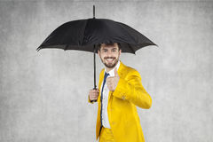Insurance agent under the umbrella Royalty Free Stock Image