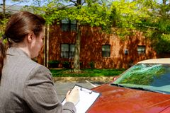 Insurance agent woman fills out form after car accident. Crash expert windshield claim person damage report writing vehicle transport examining inspection stock image