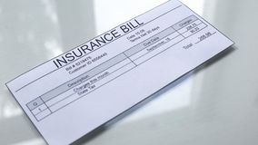 Insurance bill lying on table, payments for services, protection policy, tariff. Stock photo vector illustration