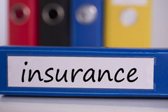 Insurance on blue business binder Royalty Free Stock Images